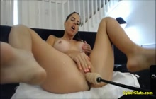 Busty babe solo with machine